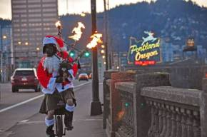 Merry Christmas everyone and here's Santa playing flaming bagpipes on aunicycle